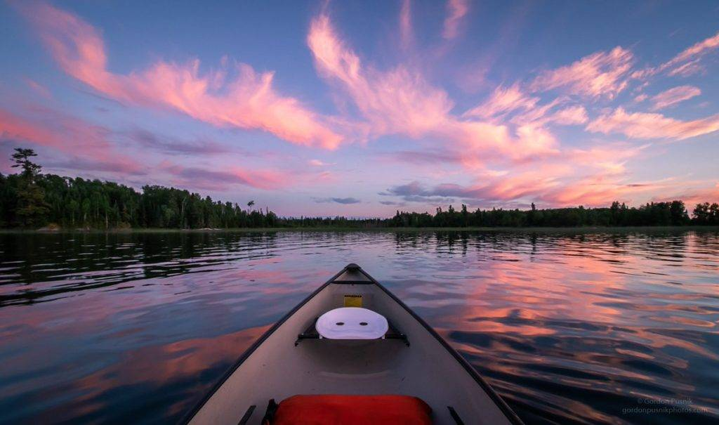 2nd Place A nice evening paddling under the cotton candy clouds - Northwest Ontario. by Gordon Pusnik @gordonpusnik