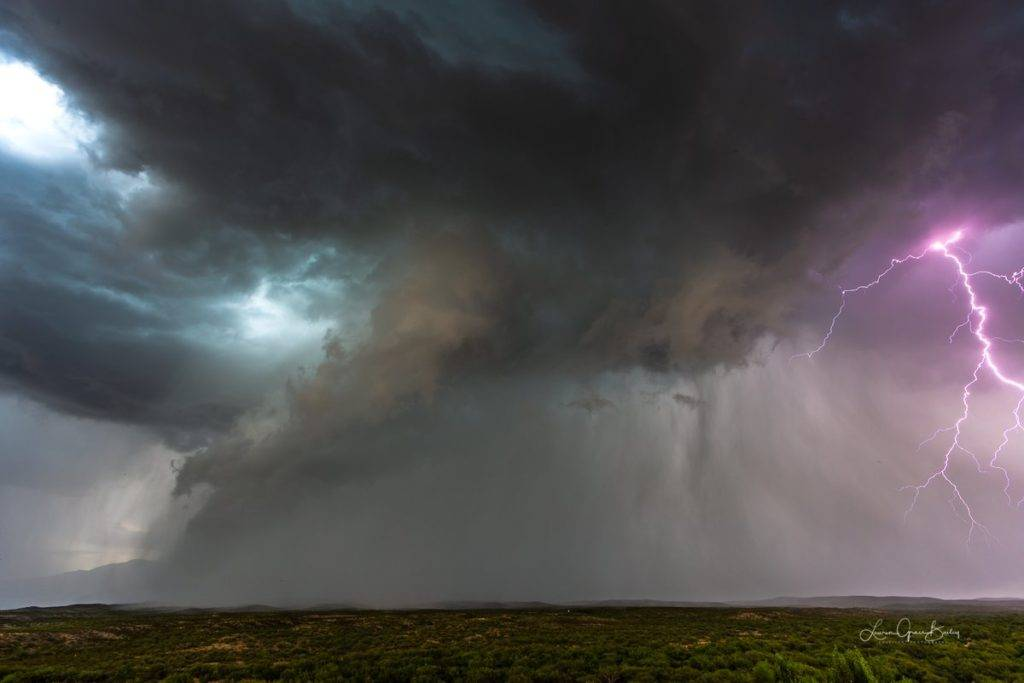 2nd Place Two storms collide and explode over the Rincon Mountains east of Tucson, Arizona by Lori Grace Bailey @lorigraceaz