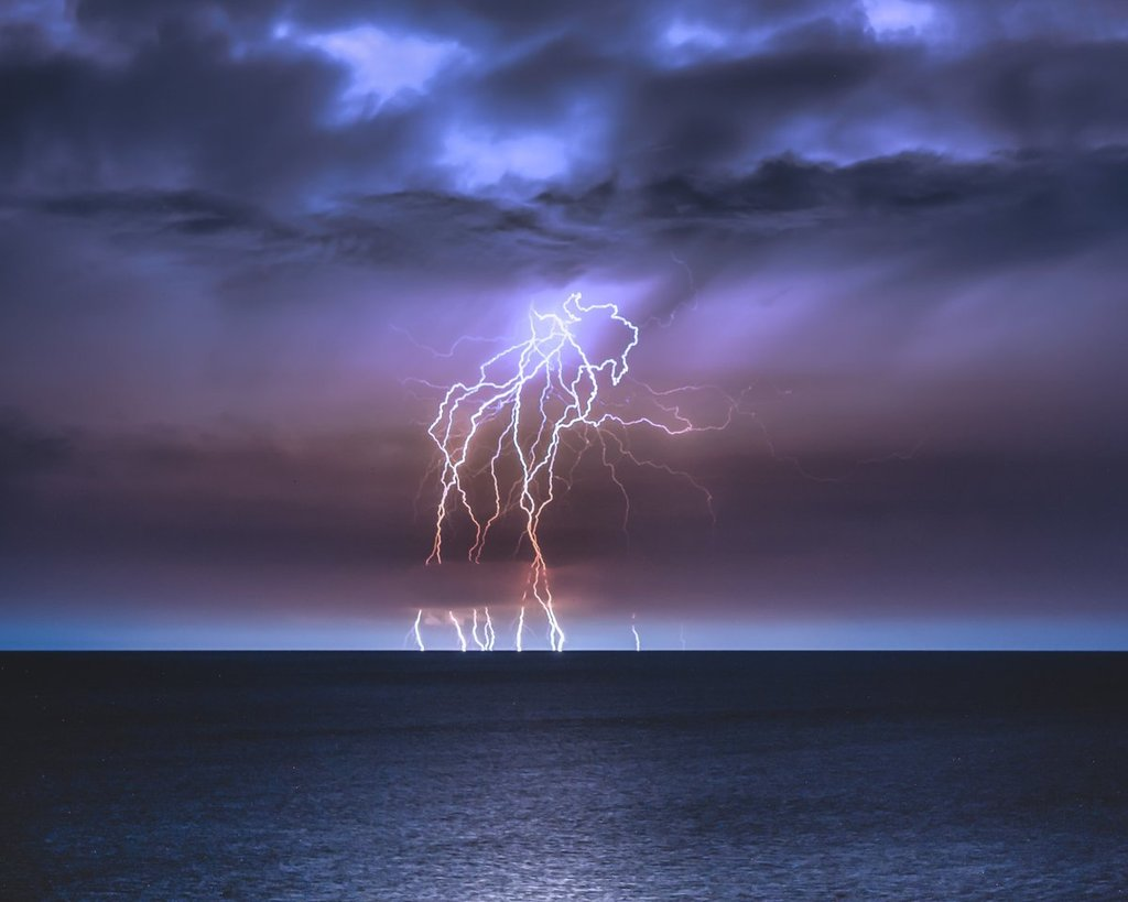 A_column_of_lightning_strikes_collected_with_a_3_min_exposure_at_Orange_Beach_by_Bradley_Huchteman_brxdlxy_1024x1024
