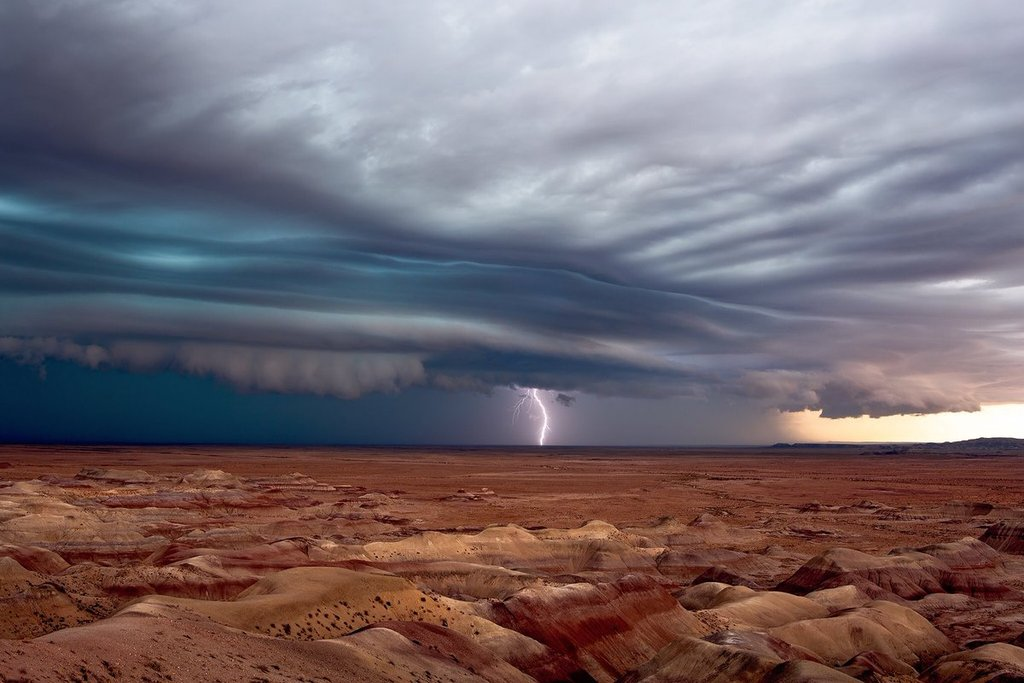 A_striated_shelf_cloud_leads_a_line_of_severe_thunderstorms_across_the_Painted_Desert_by_John_Sirlin_SirlinJohn_1024x1024