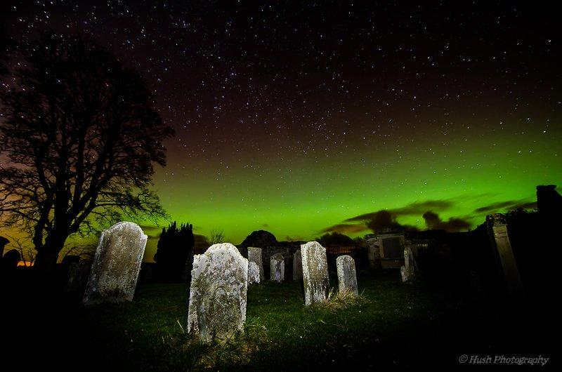 Aurora_borealis_creeping_through_the_Old_Preston_Road_graveyard_Scotland_by_Grimm_grimm_banks_1024x1024