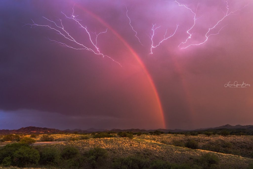 1st_Place_A_dying_storm_with_a_dazzling_double_rainbow_while_lightning_crawls_across_the_sky_last_week_near_Arivaca_AZ_by_Lori_Grace_Bailey_lorigraceaz_1024x1024