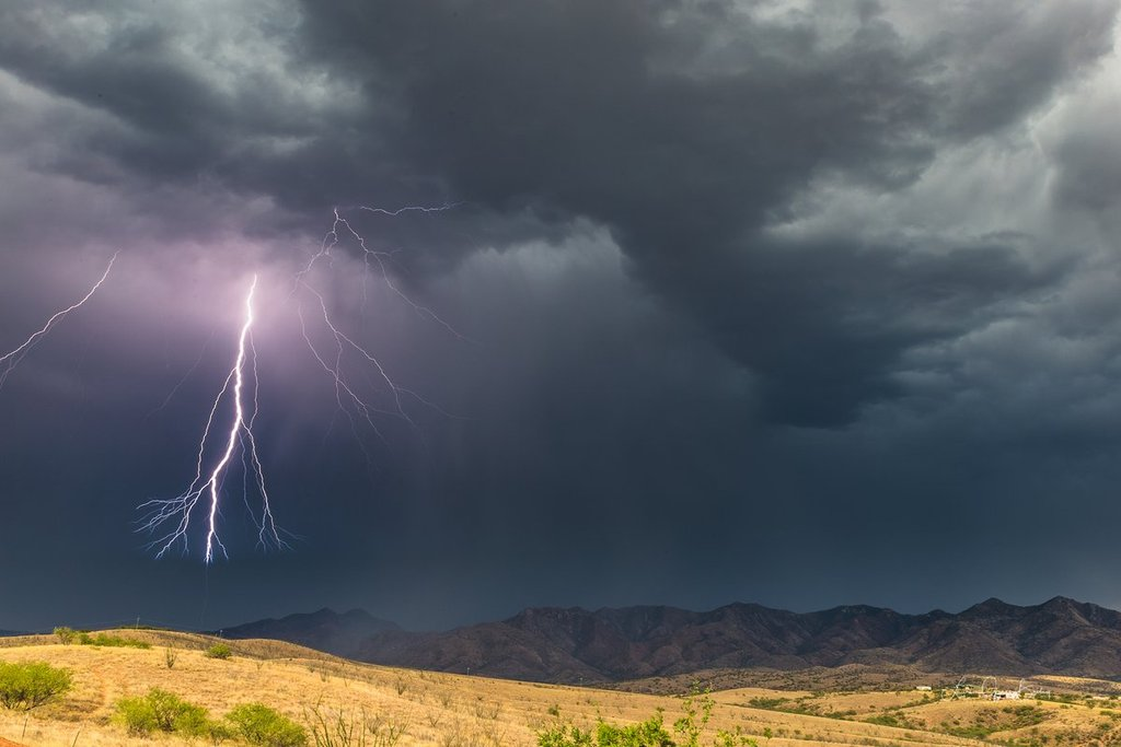 1st_Place_The_last_bolt_from_a_storm_over_the_Patagonia_Mountains_in_southern_AZ_by_Lori_Grace_Bailey_lorigraceaz_24500dc9-b7d4-43ea-88e6-60bf0ebf8fcd_1024x1024