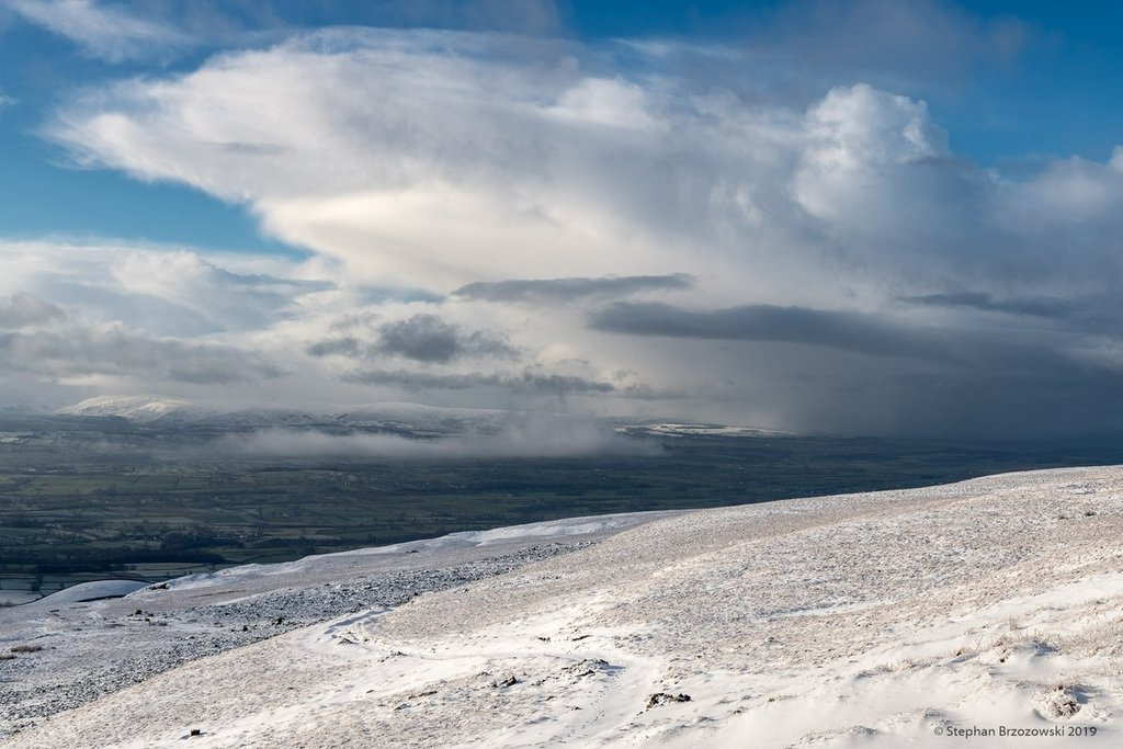 3rd_Place_Snow_shower_cloud_hovering_over_the_Eden_Valley_in_Cumbria_by_Stephan_Brzozowski_stephanbrz_1024x1024