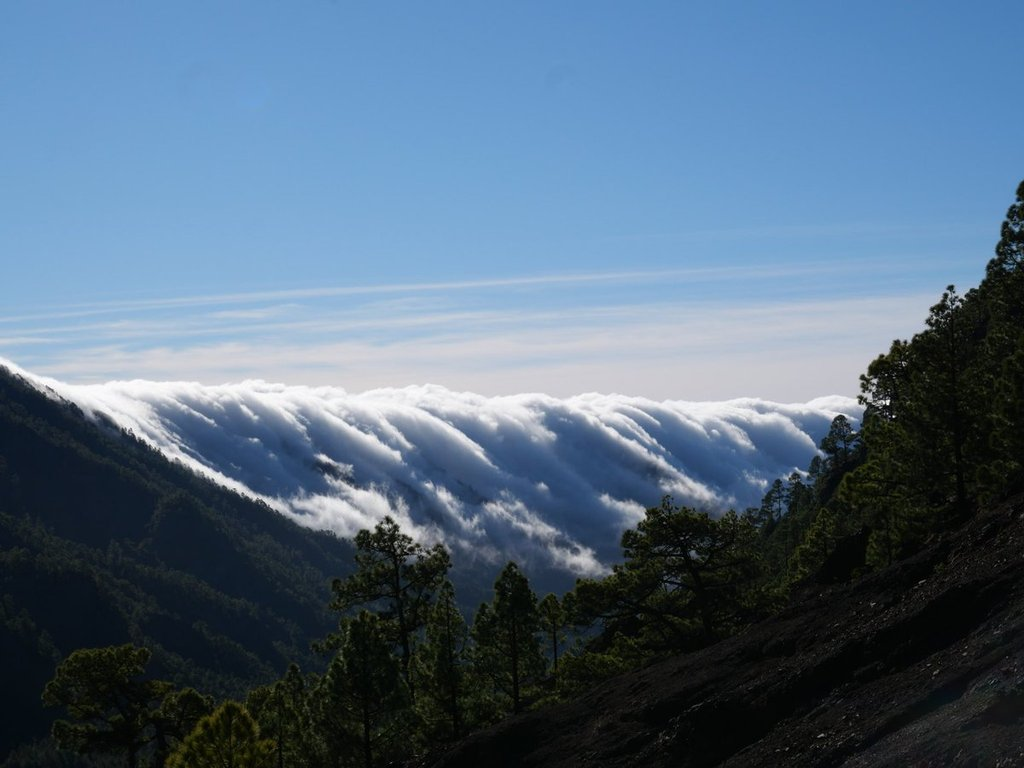 Cloud_rolling_in_over_mountain_ridge_in_Caldera_de_Taburiente_National_Park_by_Teresa_Jennings_treej9_1024x1024