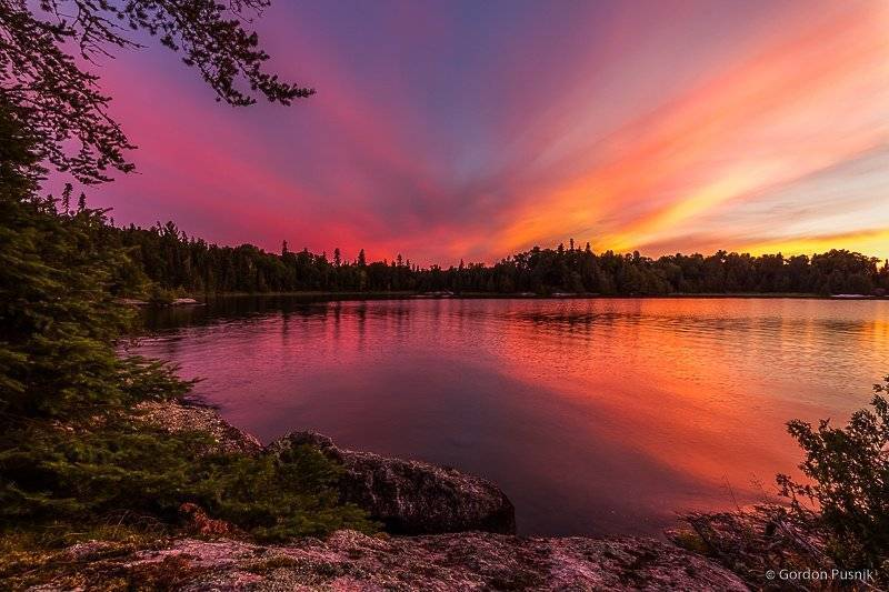 1st Place Gordon Pusnik @gordonpusnik A colorful evening at a quiet Bay in N.W. Ontario.
