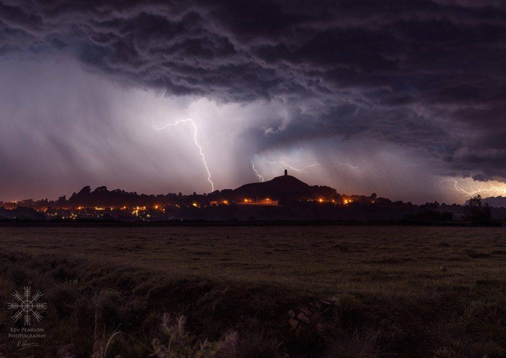 1st Place Kev Pearson @KevPearsonPhoto Thunderstorm passing over Glastonbury, UK last week. First attempt at this sort of thing & worth staying up for!