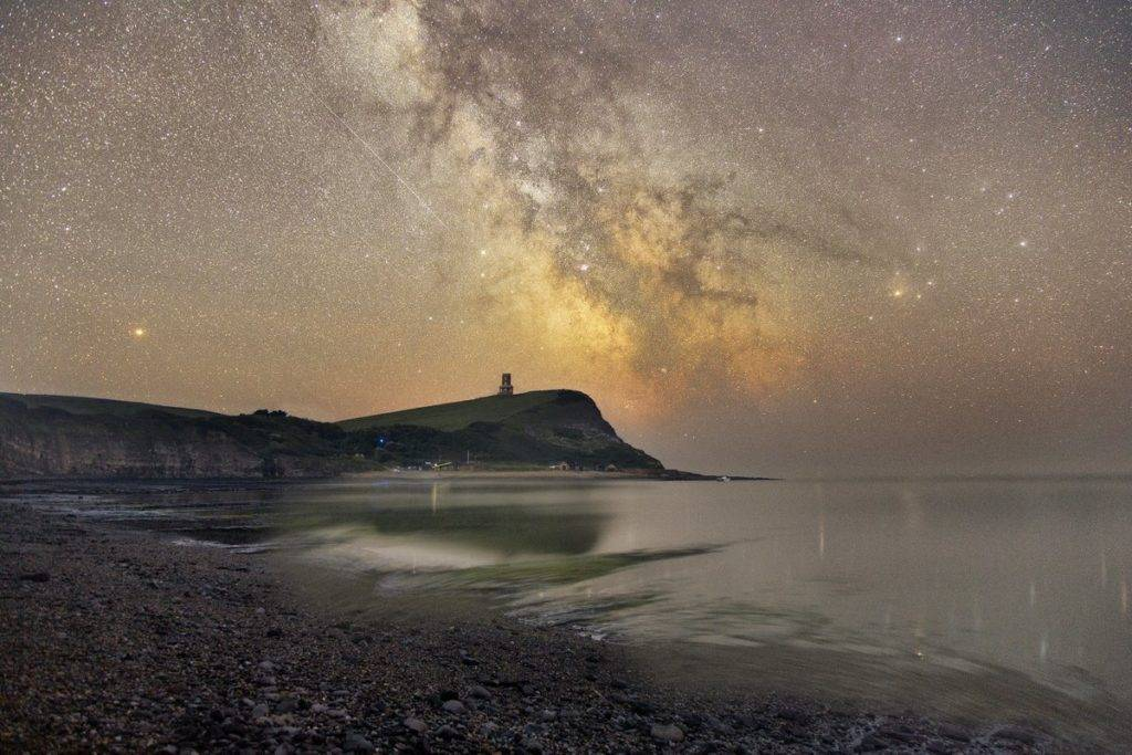 1st Place The Milkyway core rises above Clavell Tower overlooking Kimmeridge Bay in Dorset by Mark Pelleymounter @MPelleymounter