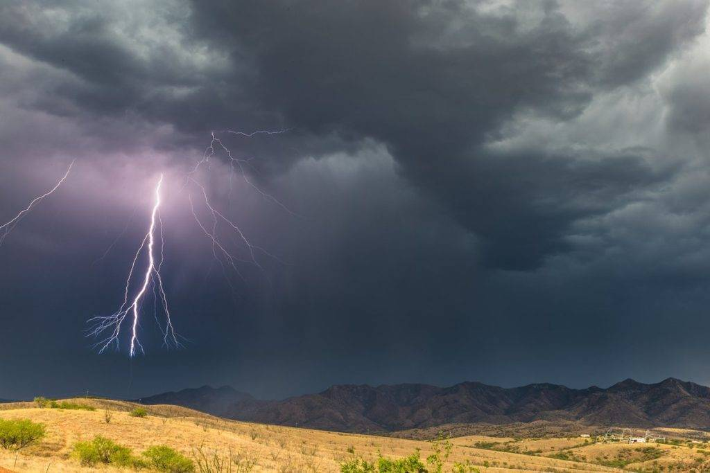 1st Place The last bolt from a storm over the Patagonia Mountains in southern AZ by Lori Grace Bailey @lorigraceaz