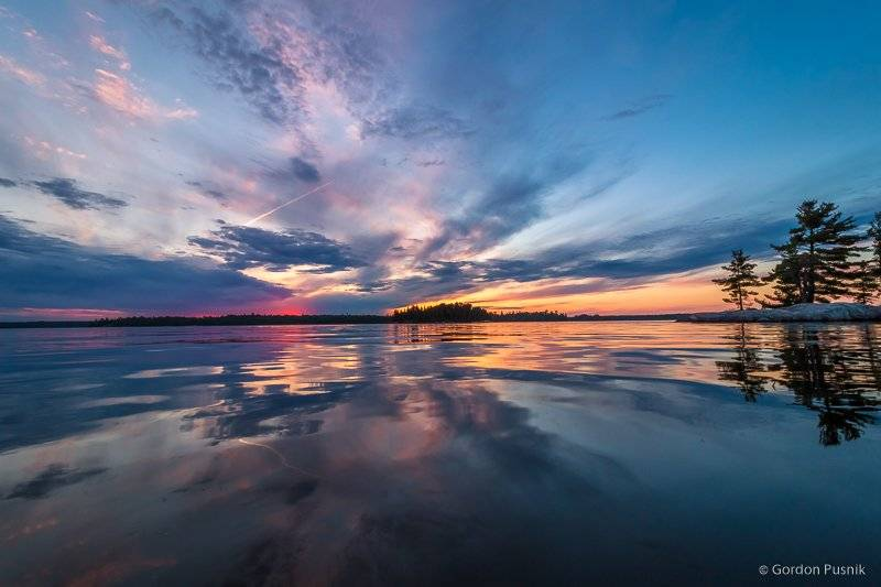 2nd Place Gordon Pusnik @gordonpusnik A colorful sunset and reflection which looked to me like a watercolor painting - N.W. Ontario, Canada.