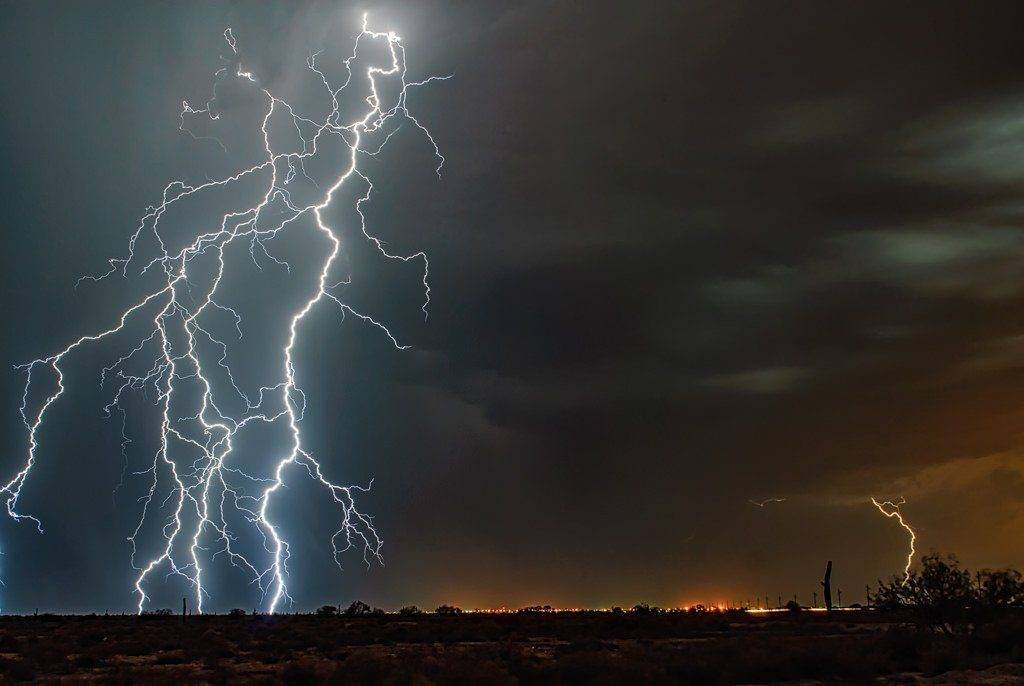 2nd Place Lightning striking south of Phoenix, looking north, during monsoon season by Scott Wood @Scott_Wood