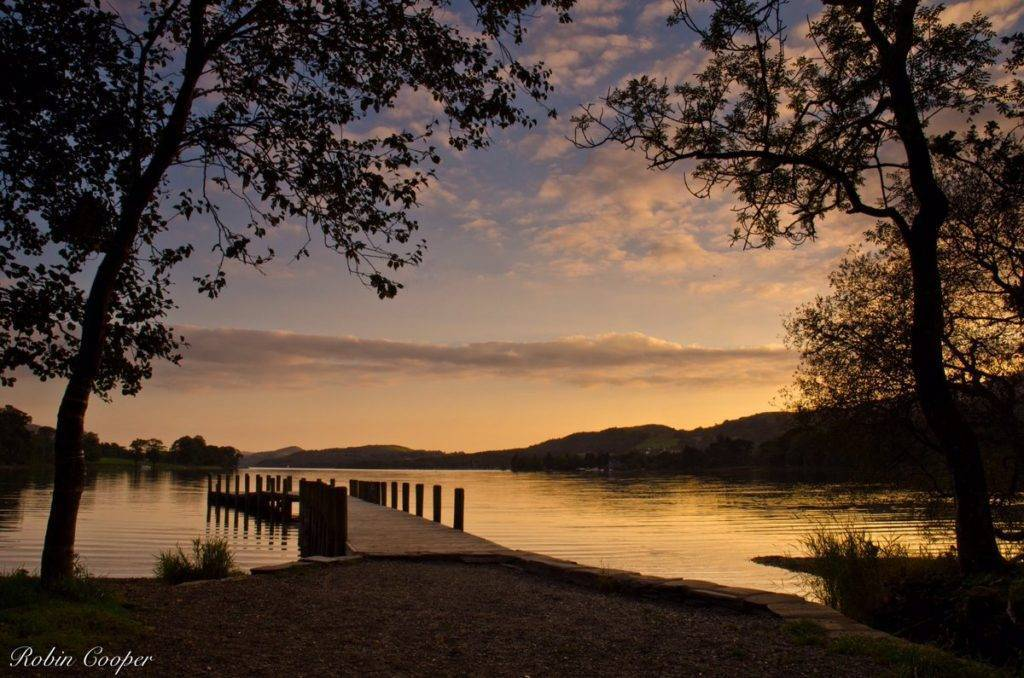 3rd Place Robin Cooper‏ @R3Cooper Waiting for the last boat home, by the light of the setting sun. Coniston Water