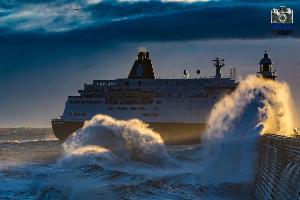 DFDS_Ferry_passing_the_end_of_the_North_Pier_Tynemouth_by_Coastal_Portraits_johndefatkin_1024x1024