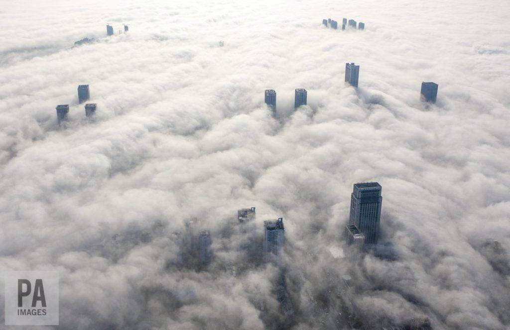 Fog swirling around the tall buildings of Yuyao City, China by Richard Holt @Richard_Holt69