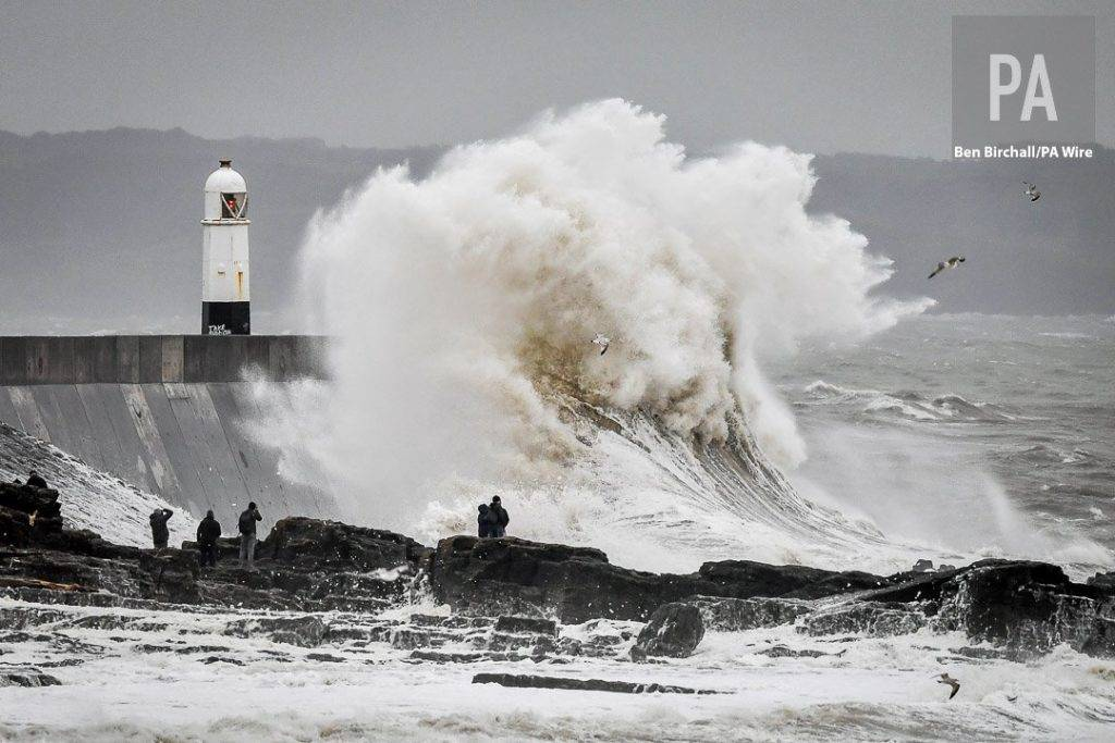 Huge waves dwarf spectators at Porthcawl, Wales by Ben Birchall @BenBirchallUK