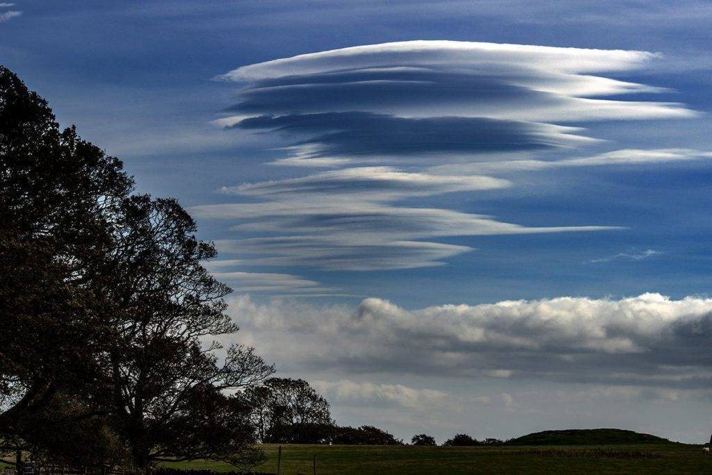 Lenticular clouds over Bolam Lake. Northumberland by Mackenzie King Photography @amkingphoto