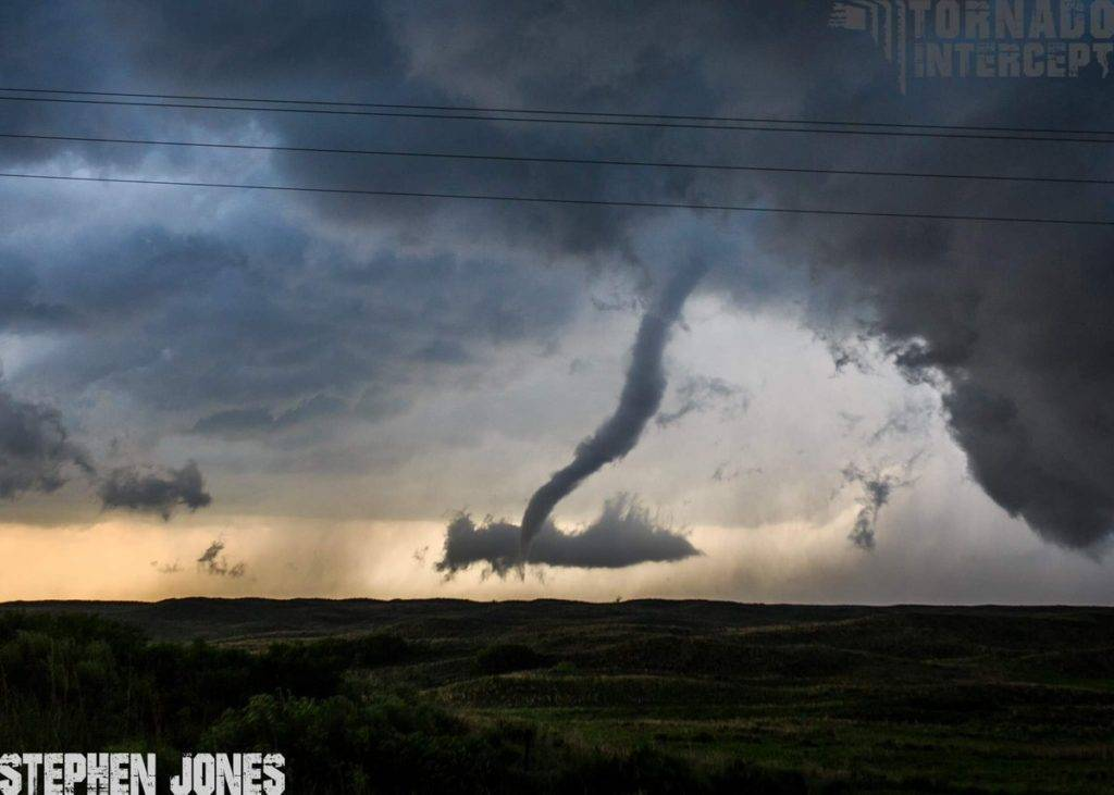 Like a snake slithering away, the Canadian, TX tornado begins it's rope-out stage into a very skinny snake like shape by Stephen Jones @Tornado_Steejo