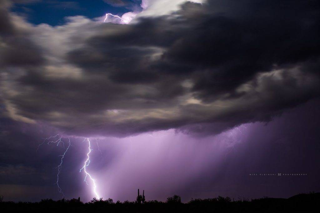 A bolt striking the ground in Arizona by Mike Olbinski @MikeOlbinski