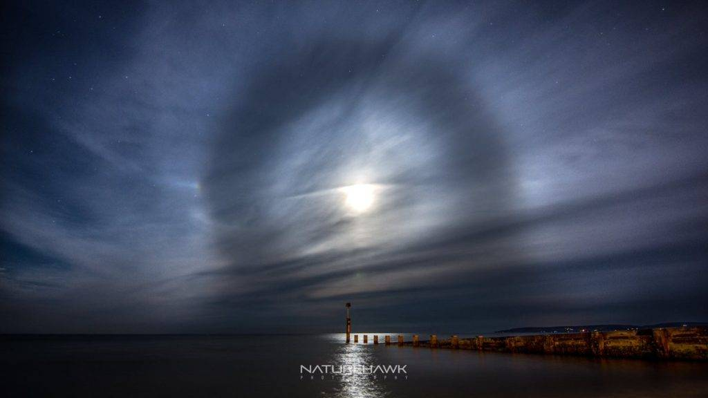 A fantastic lunar halo captured during a late night shoot on Bournemouth beach by Naturehawk Photo @NaturehawkPhoto
