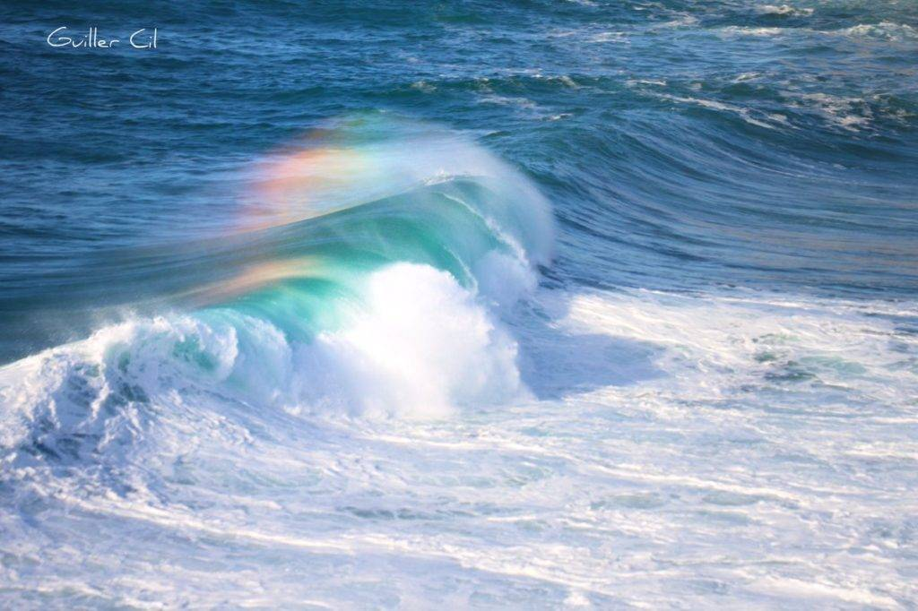 Rainbow in the spray of the waves by Guiller @GuillerCil