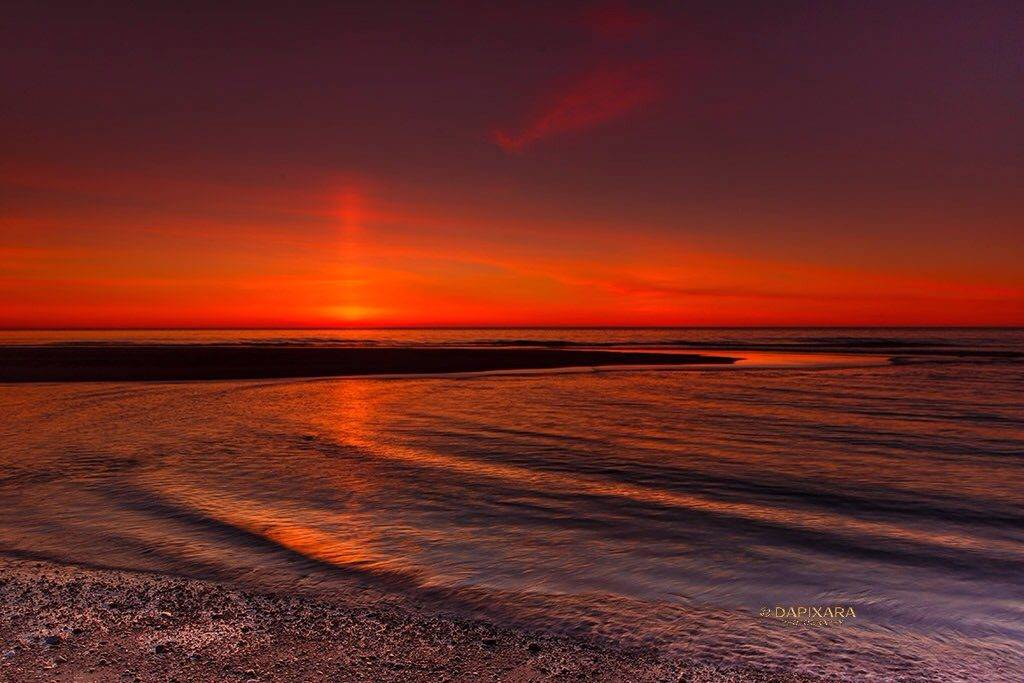 Spectacular sun pillar at Nauset beach Orleans, Cape Cod by DAPIXARA @dapixara
