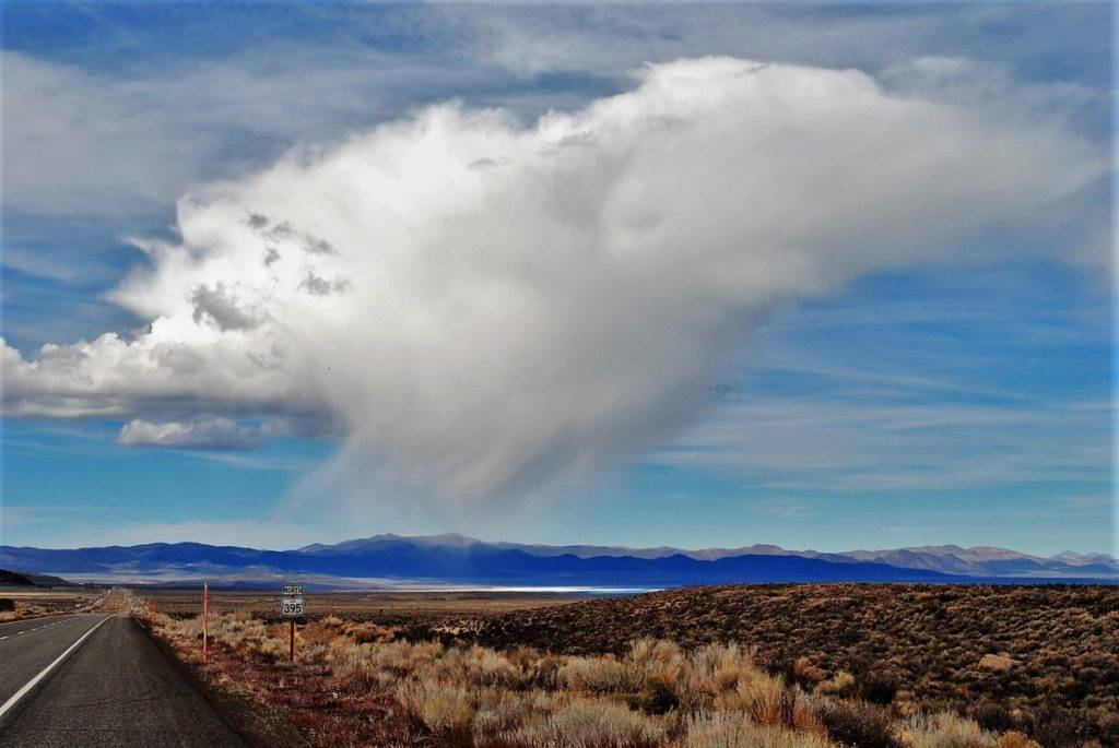 1st Place A little rain cloud popping up over Mono Lake, California, by Tom Greenough @TomGreenough