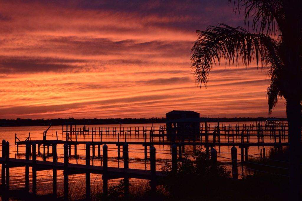 2nd Place Old boat house at dusk on the Halifax River. Ormond by the Sea, Florida by D Malone McMillan, PB&j @EzekielANovel