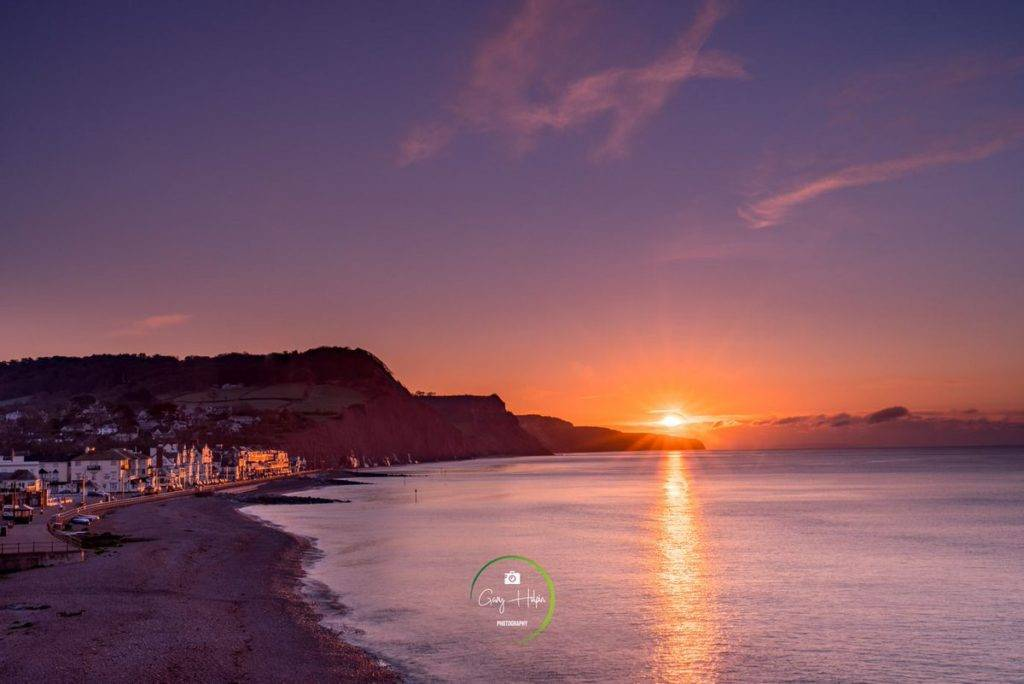 A glorious spring sunrise over Sidmouth Beach by Gary Holpin | Photography @GaryHolpin