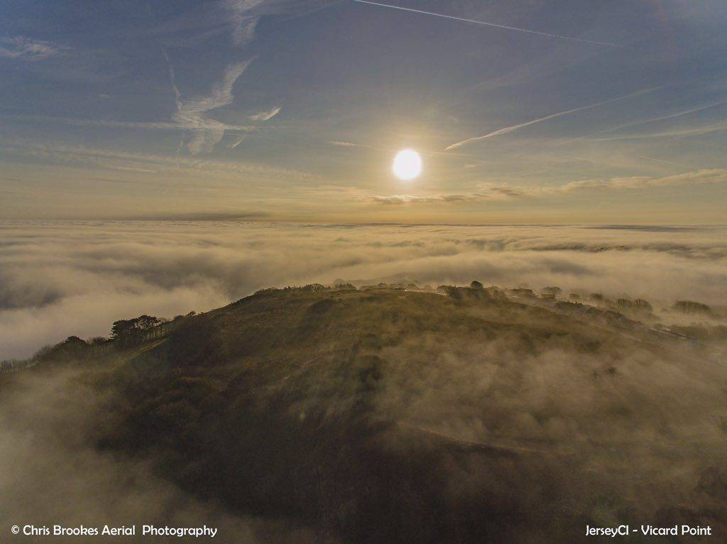 A sea of mist covering the north coast of Jersey, Channel Islands by Chris Brookes Aerial Photography @CBaerialphotos