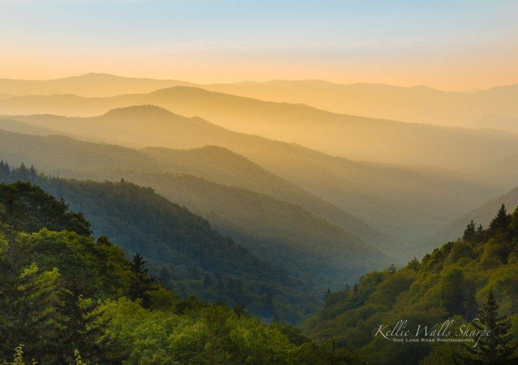 Light spilling down into the Oconaluftee River Valley at sunrise by OneLaneRoadPhotography @OneLanePhoto