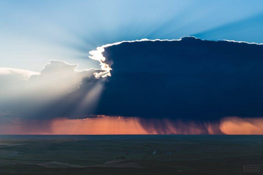 2nd Place Storm over Ritzville. Thunderstorm drifts across Eastern Washington as the sun sets by iandewarphotography @iandewarphoto