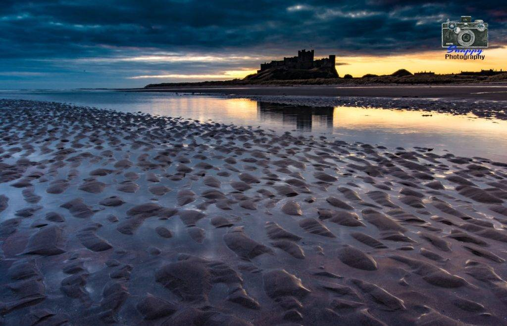 3rd Place Moody Bamburgh Sunrise by Coastal Portraits @johndefatkin