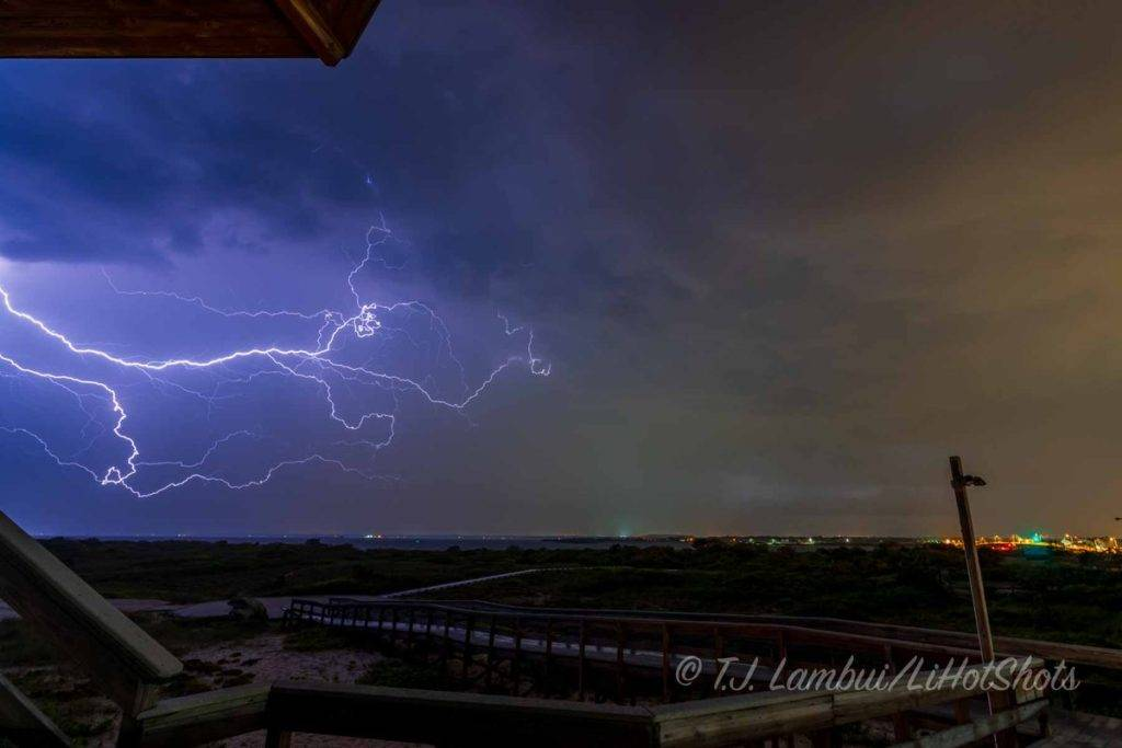 3rd Place Shirley, NY- Lightning as seen from Fire Island National Park on Long Island's south shore, looking north by LiHotShots @LiHotShots