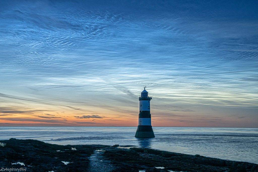 Stunning display of Noctilucent clouds over Trwyn Du, Anglesey by Phil Taylor @angleseyboy