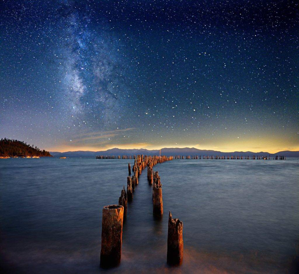Sunset to light the old pier, and Milky Way at Lake Tahoe by David Shield @DShieldPhoto