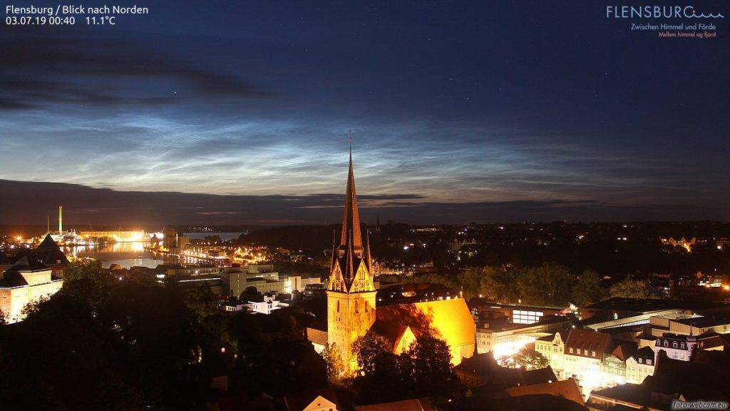 A beautiful night in Flensburg, Germany with noctilucent clouds by Tom Lowe @saloplarus