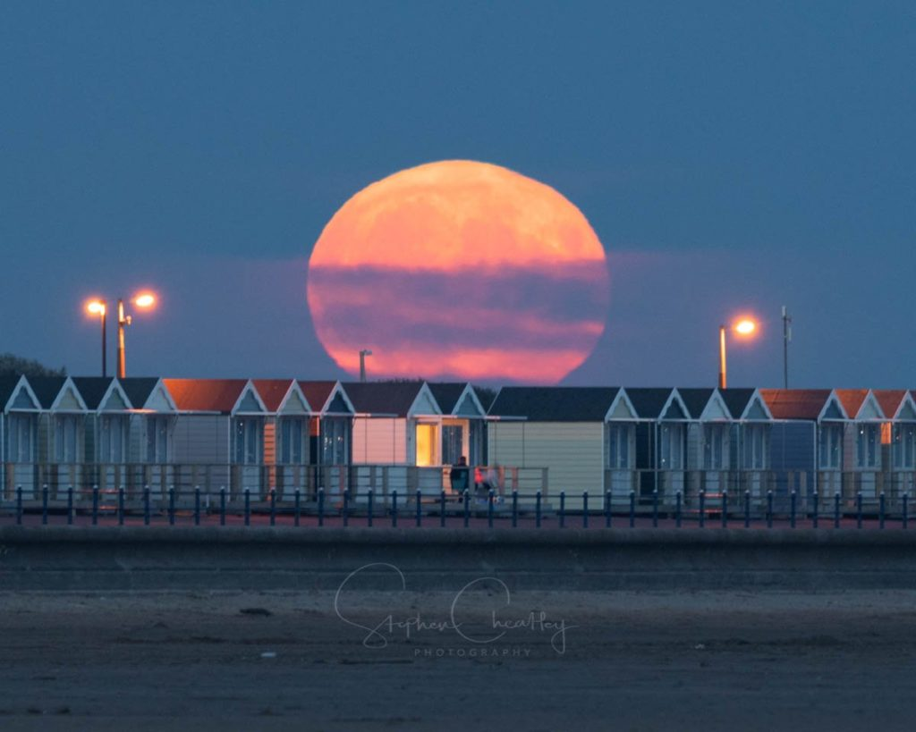 Amazing Sturgeon moonrise over the famous Beach Huts at St Annes in Lancashire by Stephen Cheatley BFC @Stephencheatley