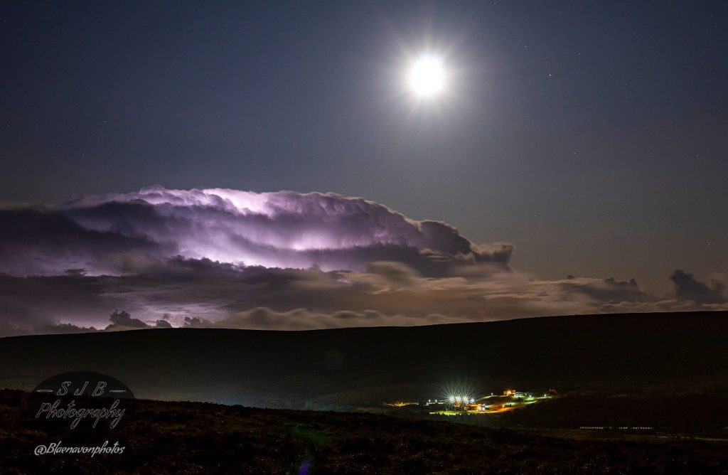Saturn to the right of the Moon and a little lightning action in the clouds above Big Pit Museum by stuArt @Blaenavonphotos