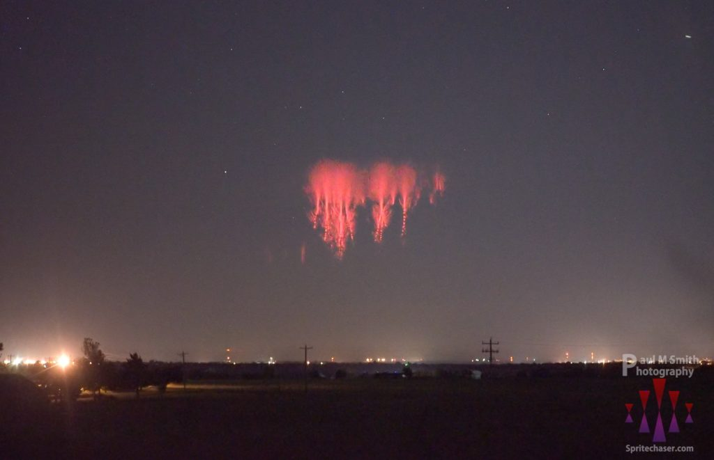 Sprites over central Oklahoma, with storms on the horizon in Northern Kansas by Paul Smith @PaulMSmithPhoto