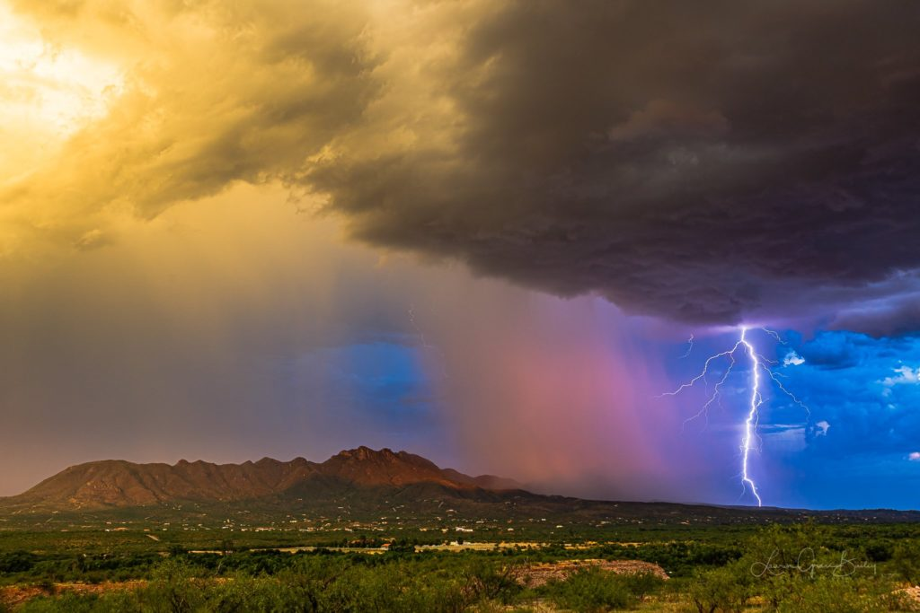 The monsoon in Arizona. Sunset colors, lightning, cloud structure, green valleys and mountain backdrops. Rio Rico. By Lori Grace Bailey @lorigraceaz