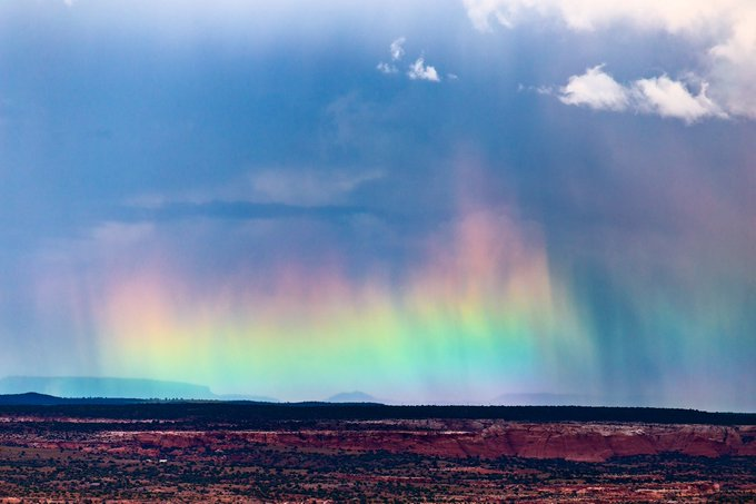 A vibrant hailbow emerges behind a departing storm near Nazlini, AZ by John Sirlin @SirlinJohn