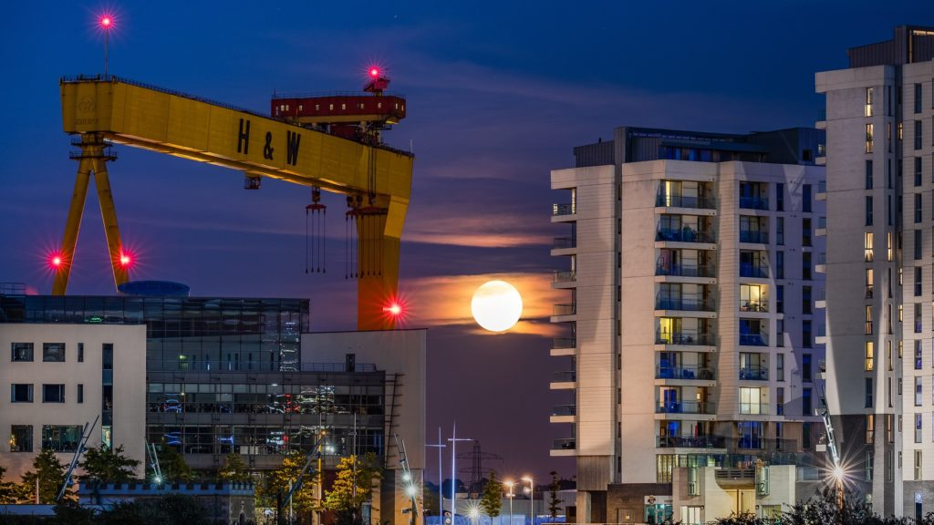 The Harvest Moon rising next to Harland & Wolff's Goliath at Titanic Quarter Belfast by Stephen Henderson @Social_Stephen