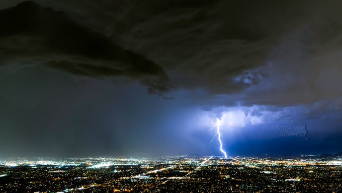 A storm sweeps across the Phoenix skyline by Christopher Scragg @monsoonchaser