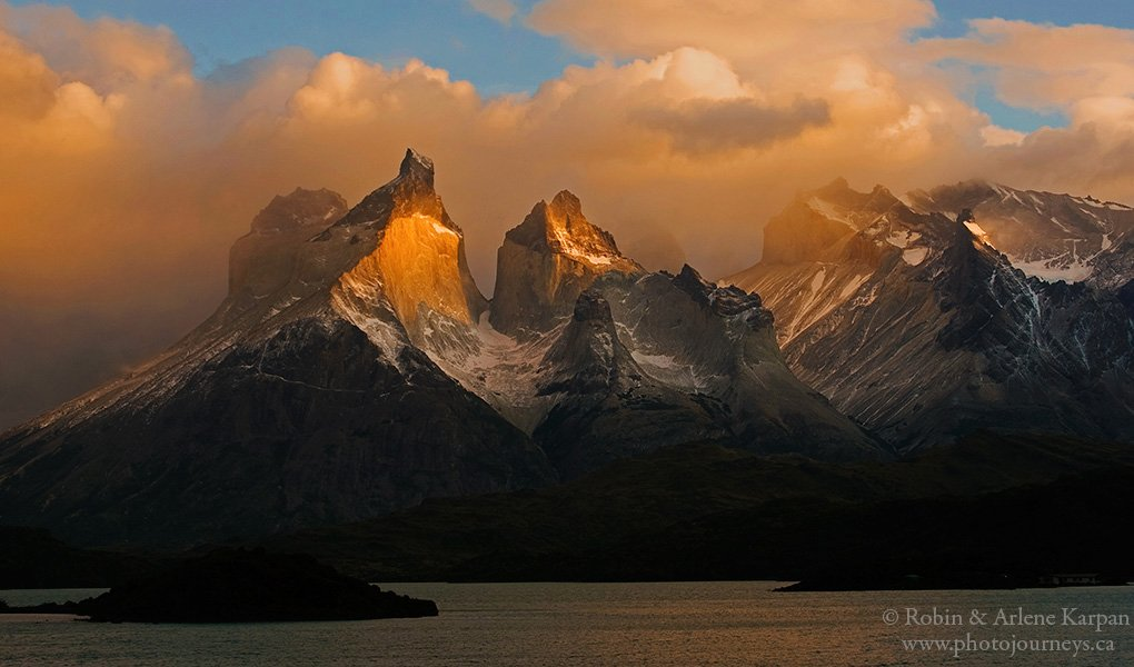 1st Place Sun breaking through the storm clouds in Torres del Paine National Park, Chile by Robin&Arlene Karpan @KarpanParkland