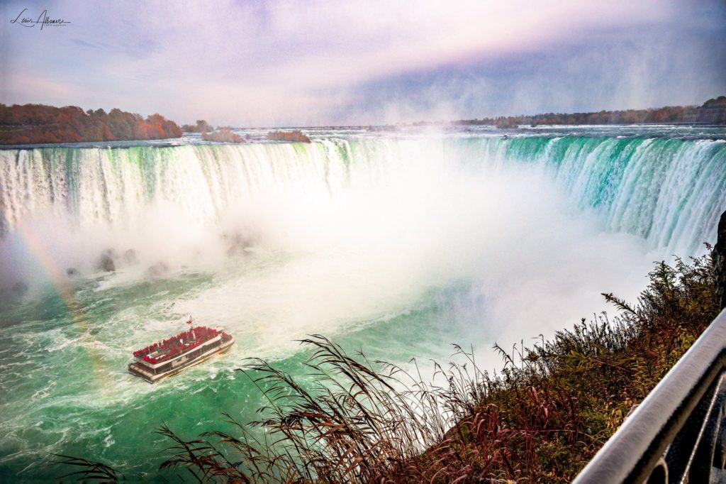 A rainbow appears behind the Hornblower at the Horseshoe Falls, Niagara Falls by Louis Albanese @DrLouisAlbanese