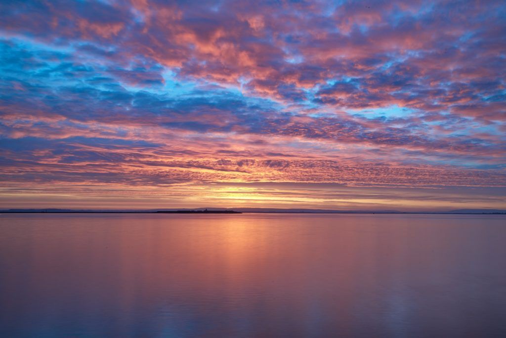 Colorful sunrise on Galway bay by WoodRoad Photography @woodroadphotos