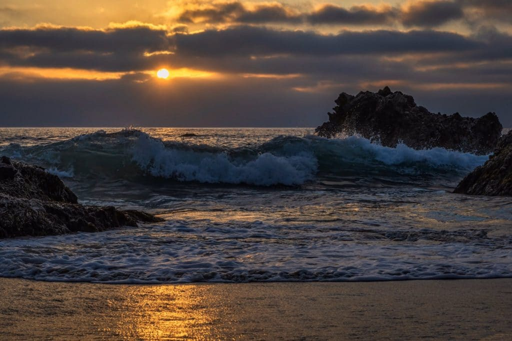 The sun trying to squeeze through the clouds at Laguna Beach, California by Michael Ryno Photo @mnryno34