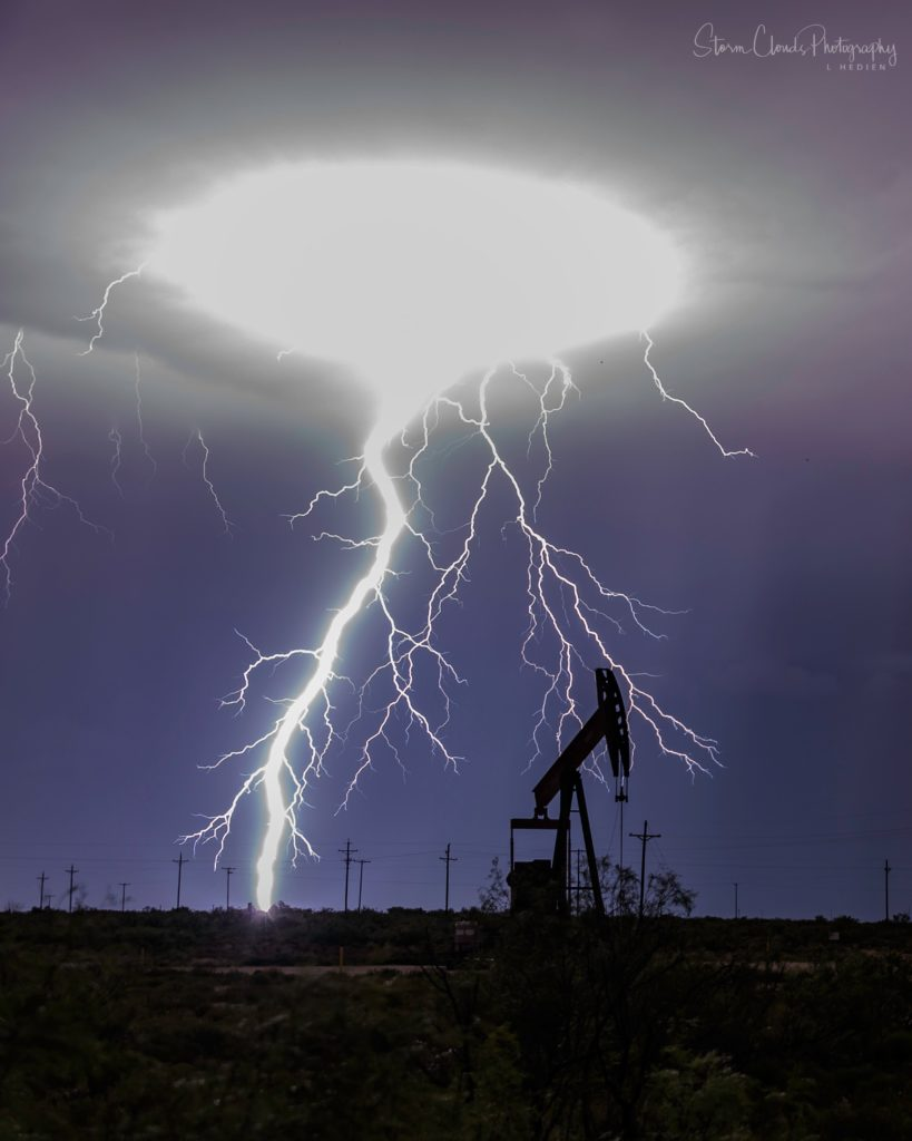 1st Place A multitude of bolts on the border of Texas and New Mexico by Laura Hedien- Storm Clouds Photography @lhedien
