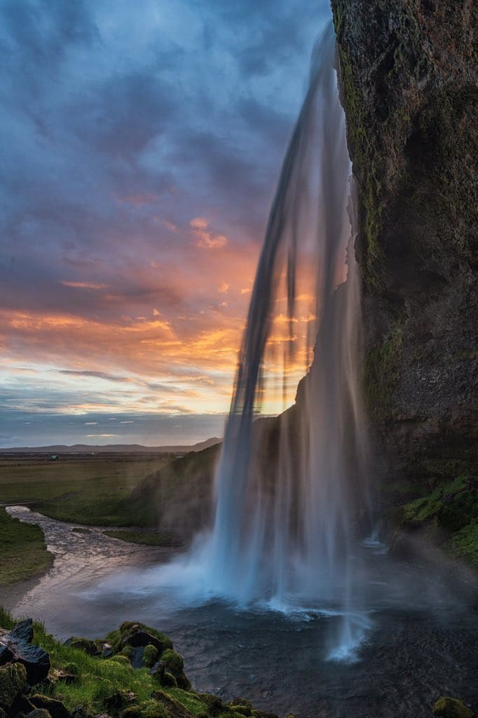 1st Place A sunrise photo from the back of Seljandsfoss in Iceland by Michael Ryno Photo @mnryno34