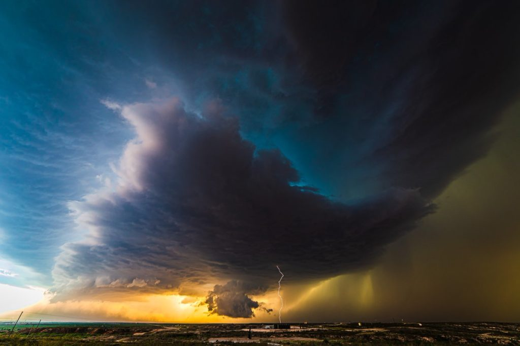 1st Place An ominous looking supercell drops a bolt of lightning by Lori Grace Bailey @lorigraceaz